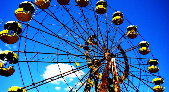 Rusted Ferris wheel, a reminder of happier years in the Chernobyl ghost town of Prypiat