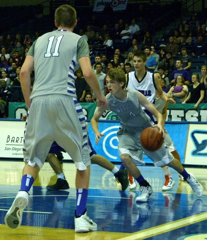 The Rock guard Holden Haskett drives through the lane