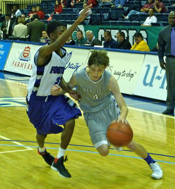 The Rock guard Holden Haskett drives against Foothills Christian guard Andre Johnson