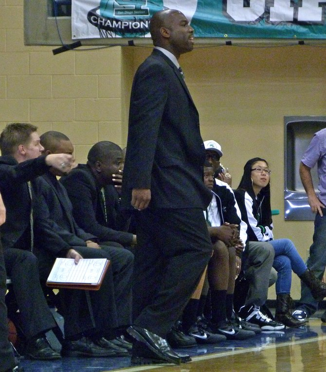 Lincoln head coach Jason Bryant looks on from the Hornets bench