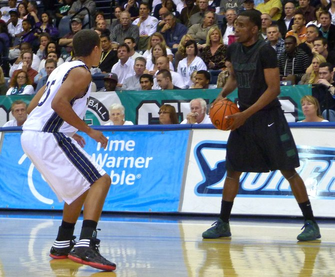 Lincoln guard Jerry Cobb marked by La Costa Canyon guard David Travers on the perimeter