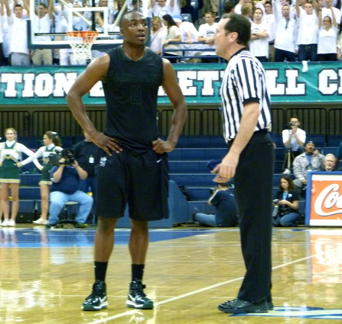Lincoln guard Tyrell Robinson has a word with the referee during a stoppage in play