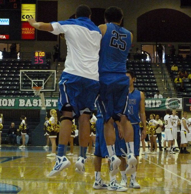 La Jolla Country Day guards Trevor Smith (left) and Jonathan Brewster perform a side bump during pregame introductions