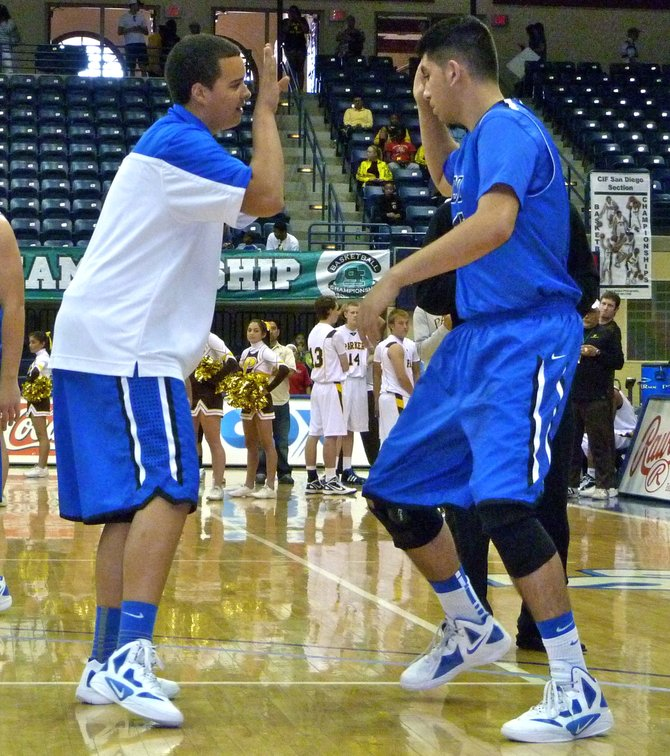 La Jolla Country Day guard Trevor Smith (left) and forward Frank Bamford cap their pregame ritual with a salute