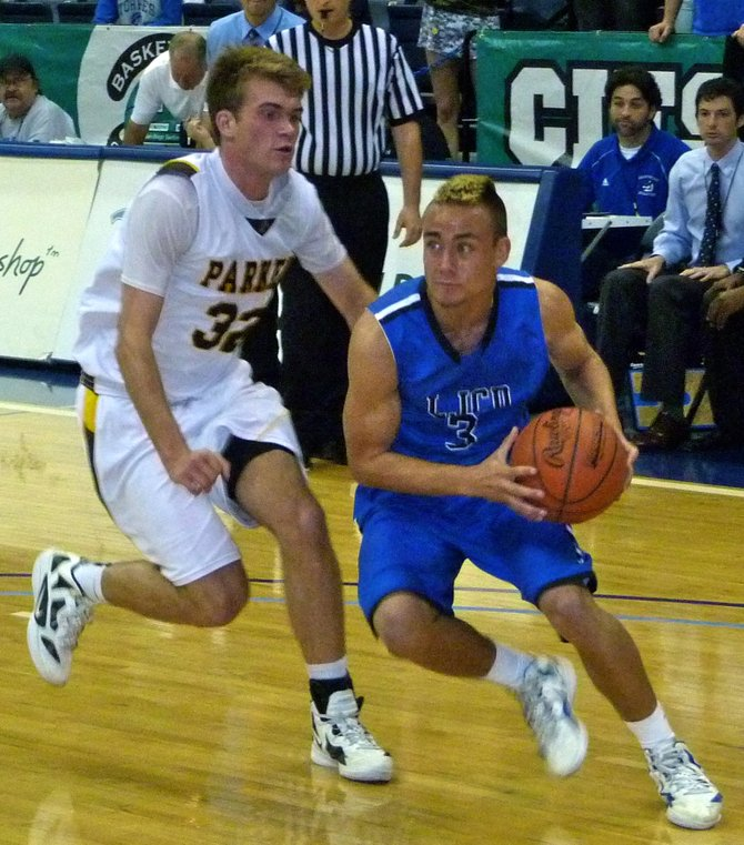 La Jolla Country Day guard Sage Burmeister drives baseline past Francis Parker guard Coleman Baker
