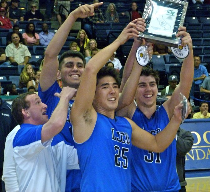 La Jolla Country Day seniors (left to right) Jack Farley, Frank Bamford, Jonathan Brewster and Nick Schlossberg celebrate with the Division IV championship plaque
