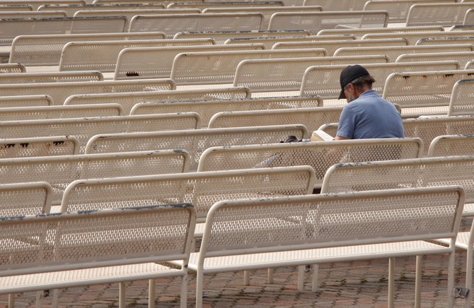 A man spends some time reading at the Organ Pavillion in Balboa Park.
