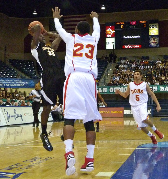 Mission Bay guard Vince Petties-Wilson puts up a shot over Cathedral Catholic guard Xavier Williams