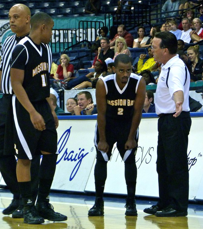 Mission Bay head coach Dennis Kane directs Buccaneers guard D.J. Mebratu during a timeout