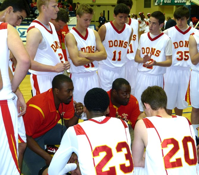 Cathedral Catholic head coach Will Cunningham talks to the Dons during a timeout