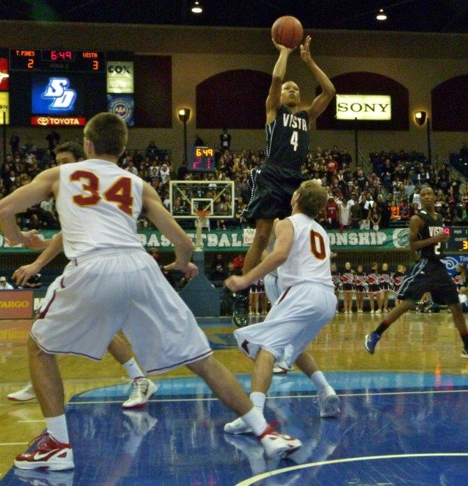 Vista guard Hakim Arnold shoots a jumper over Torrey Pines guard Sean Murray