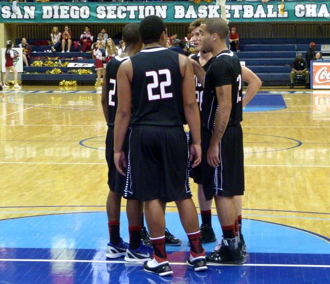 Vista players huddle up during a timeout on the floor