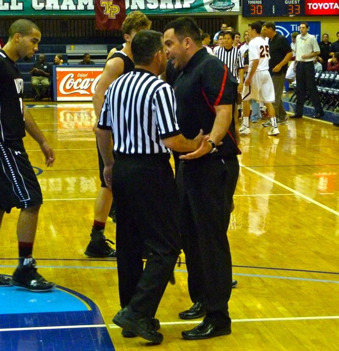 Vista head coach Charlie Mercado shares his opinion with an official during a timeout