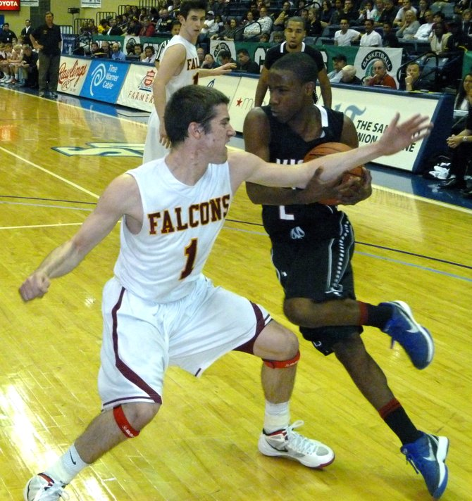 Vista guard John Fletcher fights through the contact of Torrey Pines guard Joe Rahon on the drive