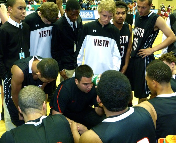 Vista head coach Charlie Mercado addresses the Panthers during a timeout