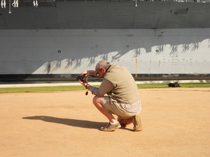 "Ocean Beach photographer Michael Realpeople aiming for a photo op at the ""Unconditional Surrender"" statue downtown."