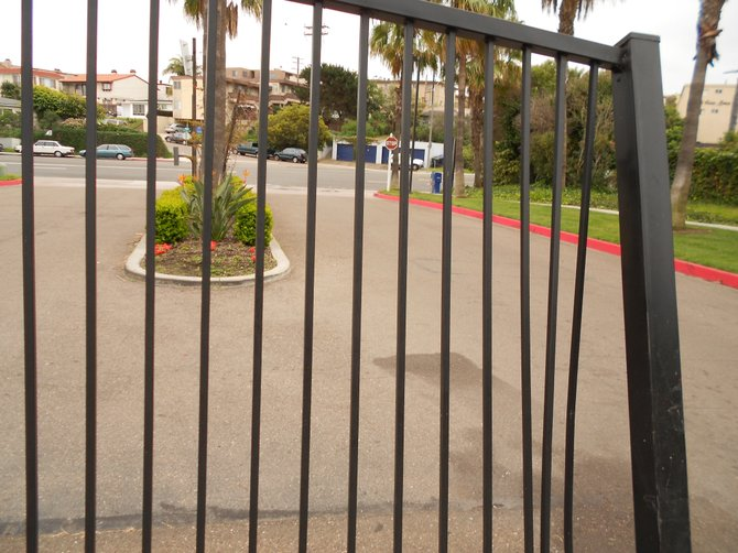 "Broken ""security gate"" that was rammed by a resident at Mariner's Cove Apartments in Ocean Beach."