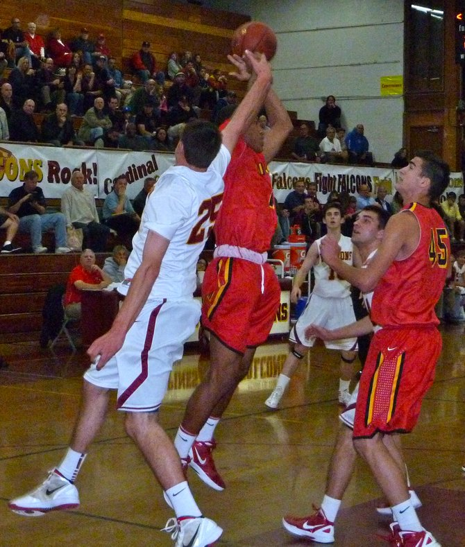 Mission Viejo guard Max Redfield pulls down a rebound in front of Torrey Pines forward Sam Worman