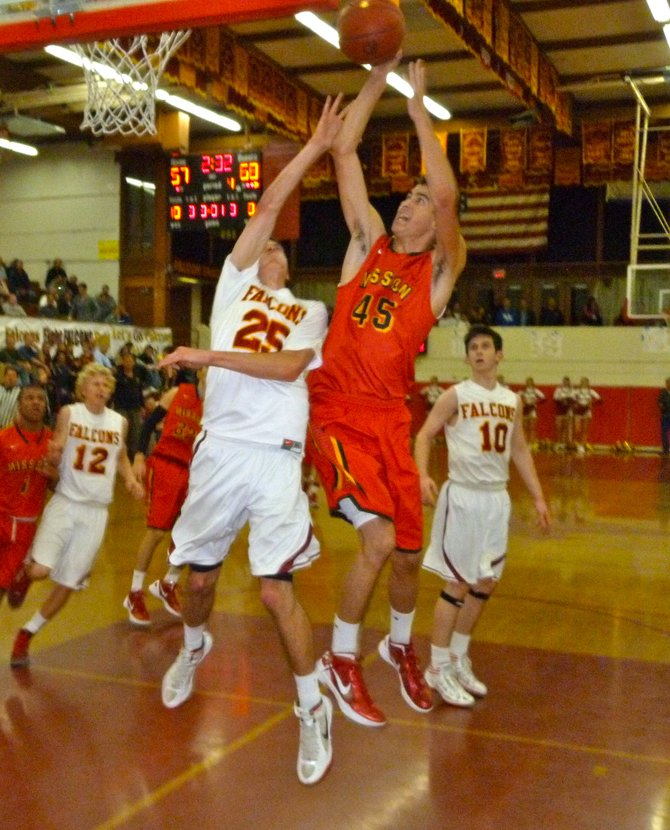 Mission Viejo forward Sage Stone streaks to the hoop over Torrey Pines forward Sam Worman