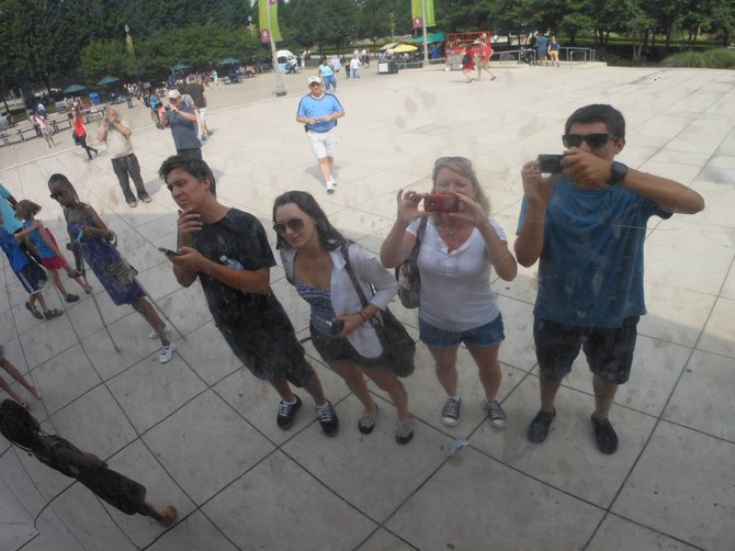 "Taking a picture of our reflection at Chicago's ""BEAN"" officially called Cloud Gate, in Millennium Park"