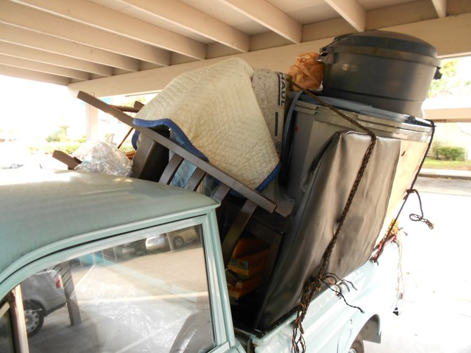 Car full of crap being stored illegally at Mariner's Cove apartments.