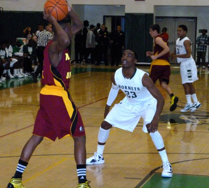 Lincoln guard Tyree Robinson picks up Tulare Union guard William Stallworth in the backcourt