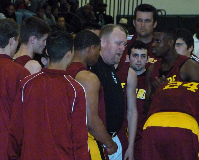 Tulare Union huddles up around coach Mark Hatton during a timeout