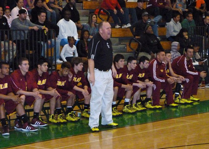 Tulare Union coach Mark Hatton shares his opinion with the officials from the Redskins bench
