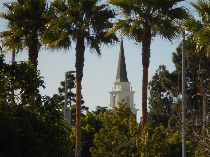 Red Brick Church steeple in Point Loma framed by trees.