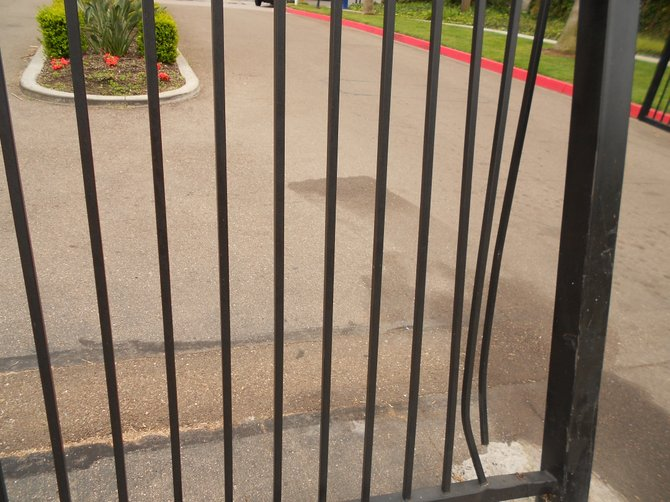 "Broken gate rammed by resident at ""gated community"" of Mariner's Cove Apartments."