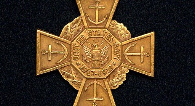 """The Tiffany Medal of Honor"""" awarded to Commander Izac."""