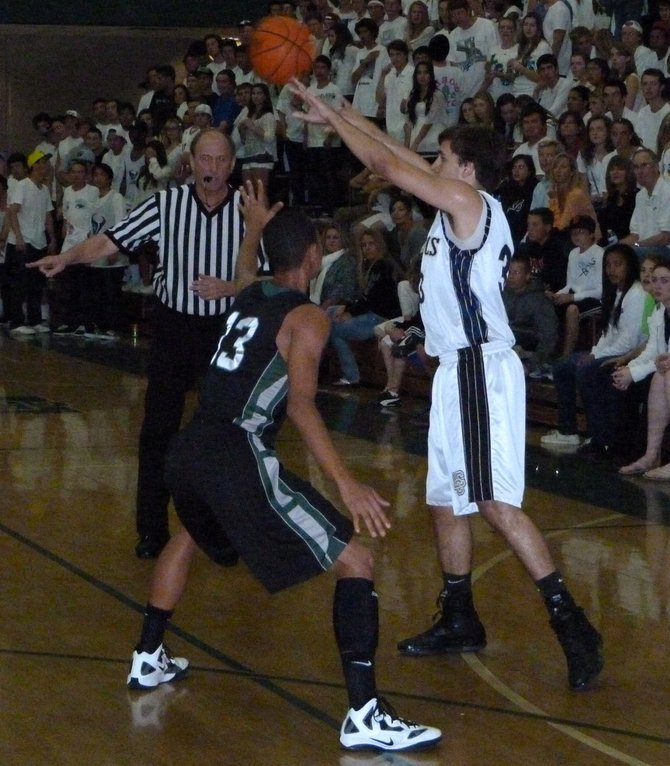La Costa Canyon forward Zach Beery passes the ball with Inglewood guard Edward Scott Jr. defending