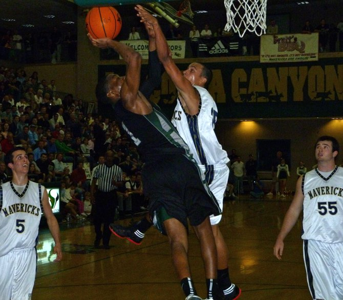 Inglewood guard Randy Onwuasor goes up to the hoop against La Costa Canyon guard David Travers