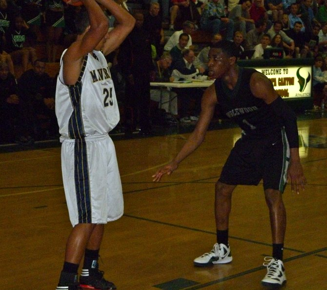 La Costa Canyon guard David Travers defended by Inglewood guard Randy Onwuasor in the backcourt