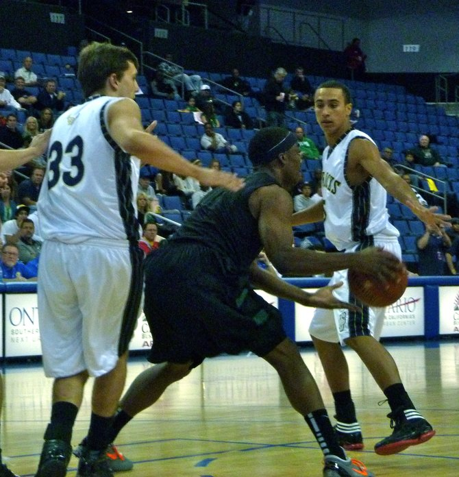 Lincoln guard Tyrell Robinson double teamed by La Costa Canyon forward Zach Beery (left) and guard David Travers inside