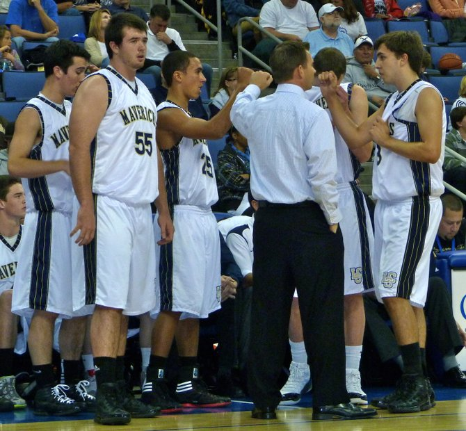 La Costa Canyon's starting five huddles up around head coach Dave Cassaw during a timeout