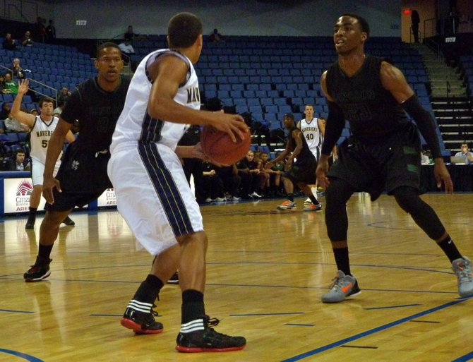 La Costa Canyon guard David Travers pressed by Lincoln forward Jeremiah Turner (left) and guard Tyree Robinson