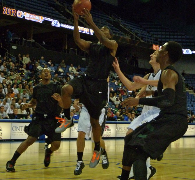 Lincoln guard Tyrell Robinson elevates to the hoop in traffic