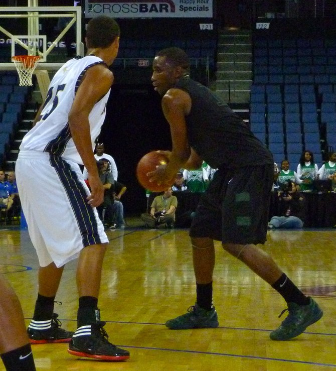 Lincoln guard Jerry Cobb covered by La Costa Canyon guard David Travers on the perimeter