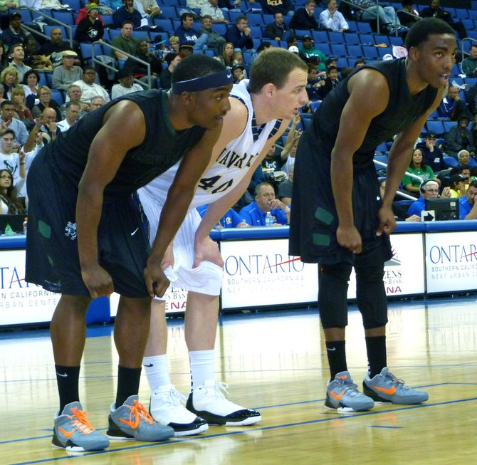 La Costa Canyon forward Matt Shrigley flanked by Lincoln guards Tyrell Robinson (left) and Tyree Robinson in the low block