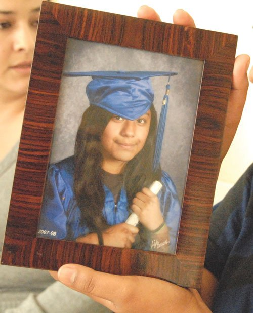 A photo of Sandra Salgado, 14, killed in the park