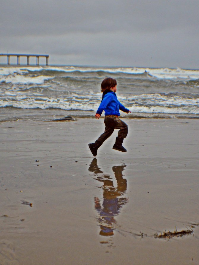 My son skipping in Ocean Beach