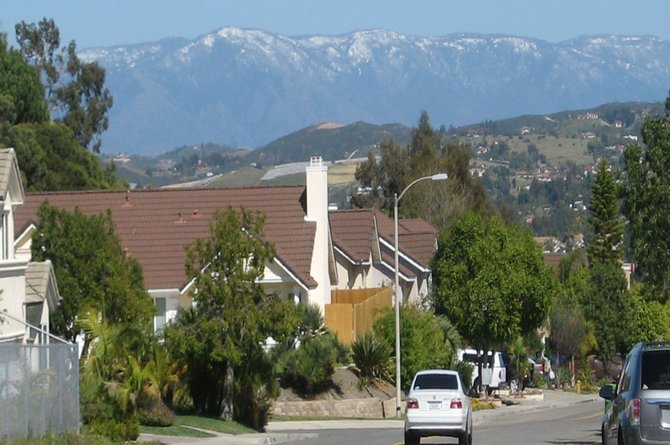 Snow on the mountains as seen from Oceanside neighborhood.