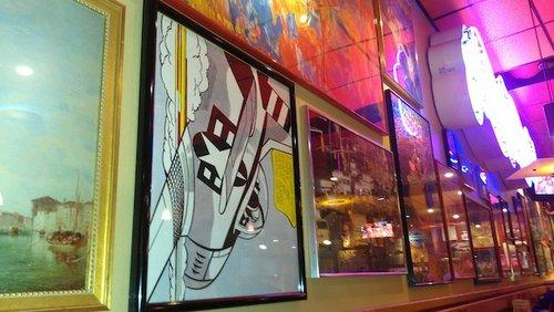 Bizarre sideways art on the wall