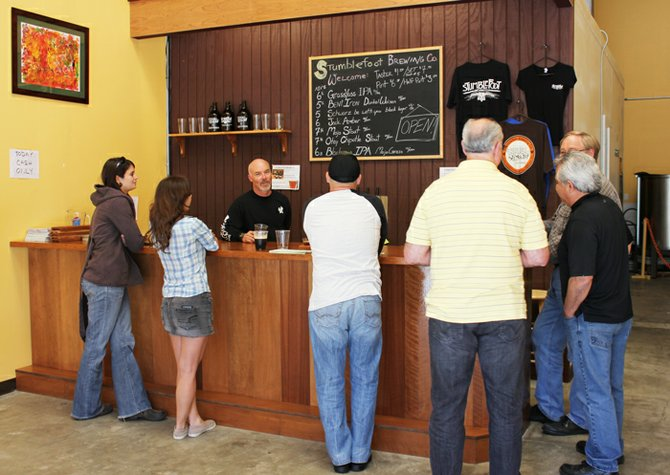 Owner and brewer explains his beers to customers at the San Marcos company's tasting room.