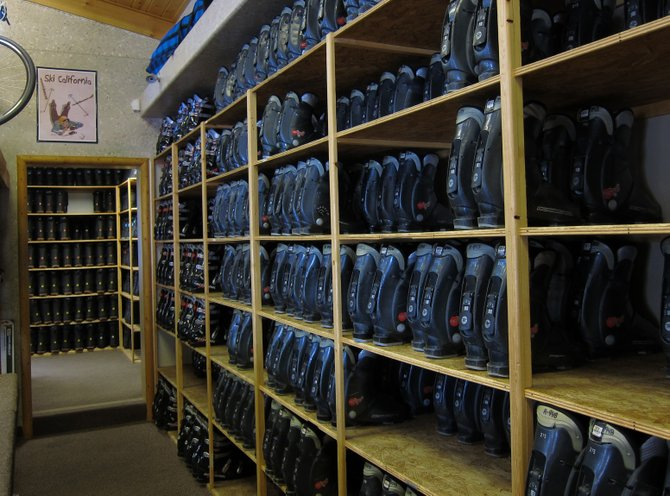 Rows of boots waiting to be rented at the snowboard rental shop in Big Bear.