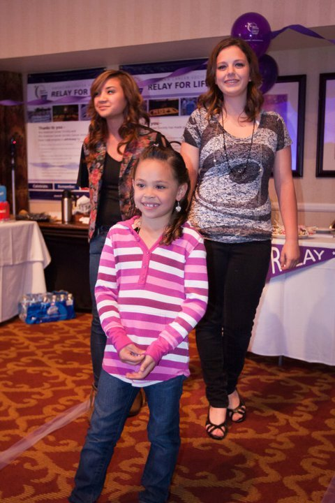 Young cancer survivor models at last year's fashion show