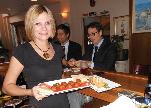 Rosalie with a plate of Greek meatballs