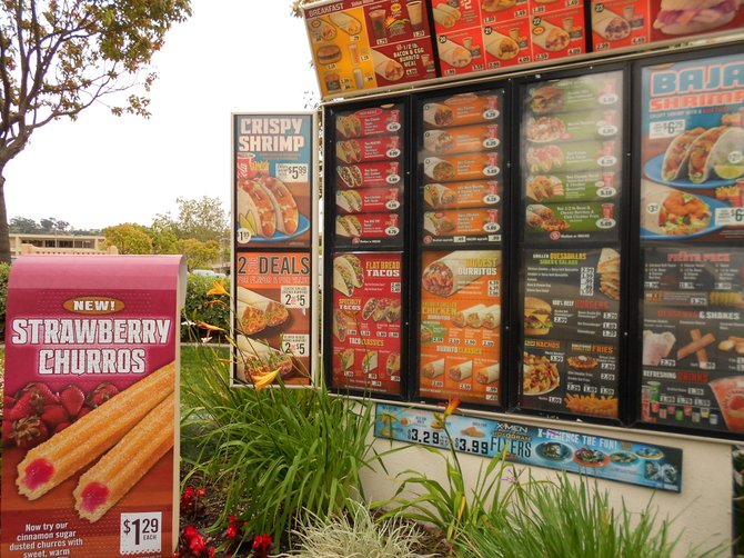 Colorful signs at Del Taco in Mission Valley.