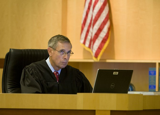 Judge Richard Mills excused one juror and put in an alternate after a full day of deliberations.  PHOTO NICK MORRIS